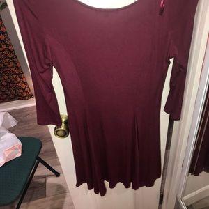 Maroon, form fitting dress.